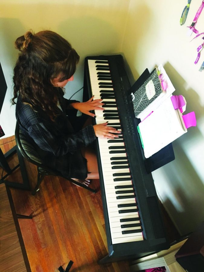 Gabrielle Budihas plays piano, sings and producers music in her room. She will be performing some of her originals.