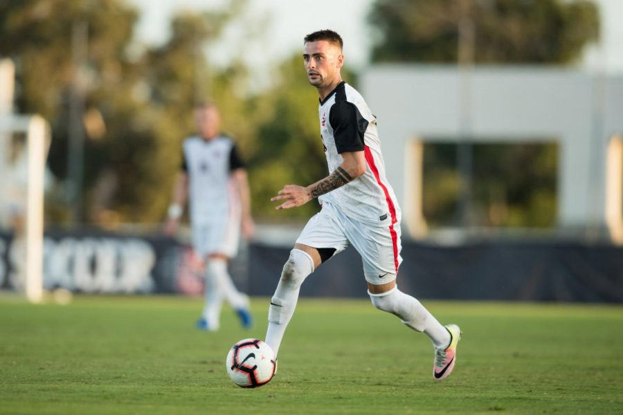 Junior midfielder Keegan Kelly dribbles the ball up the field during the Aztecs' 3-2 loss against the Detroit Mercy Tigers on Sept. 9 at the SDSU Sports Deck.
