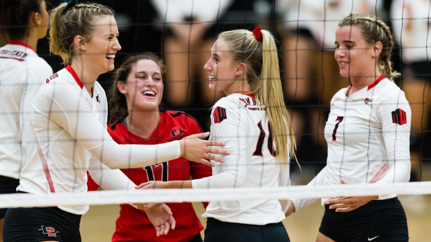 Junior setter Camryn Machado celebrates with her teammates after winning a point.