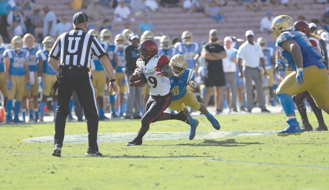Senior running back Juwan Washington carries the ball during the Aztecs' 23-14 victory over UCLA on Sept. 7 at the Rose Bowl in Pasadena.