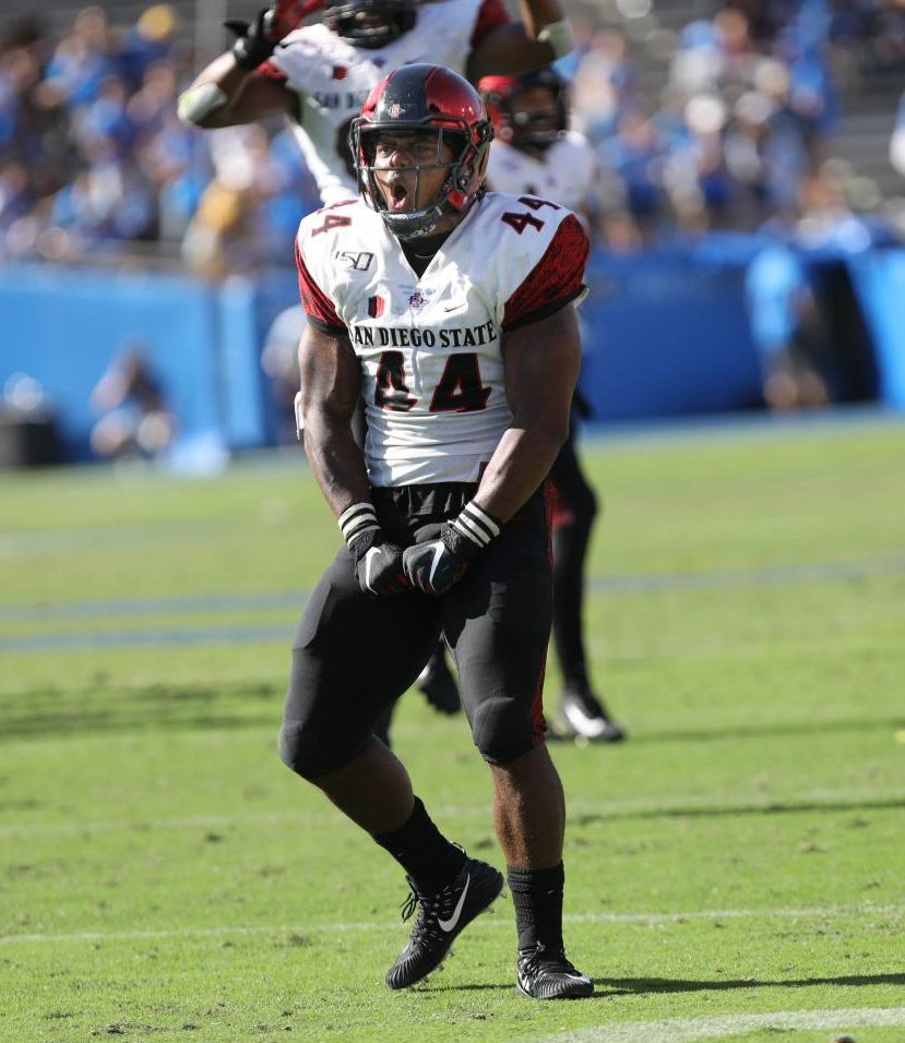 Senior linebacker Kyahva Tezino celebrates a tackle for loss during the Aztecs' 23-14 victory over UCLA on Sept. 7 at the Rose Bowl in Pasadena.