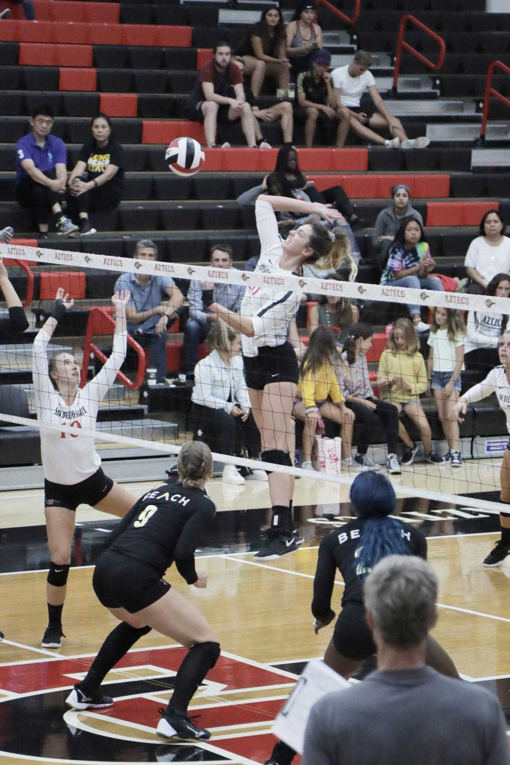 Junior outside hitter Lexie Hamrick goes up for the kill during the Aztecs' 3-1 win over Long Beach State on Sept. 19 at Peterson Gym.