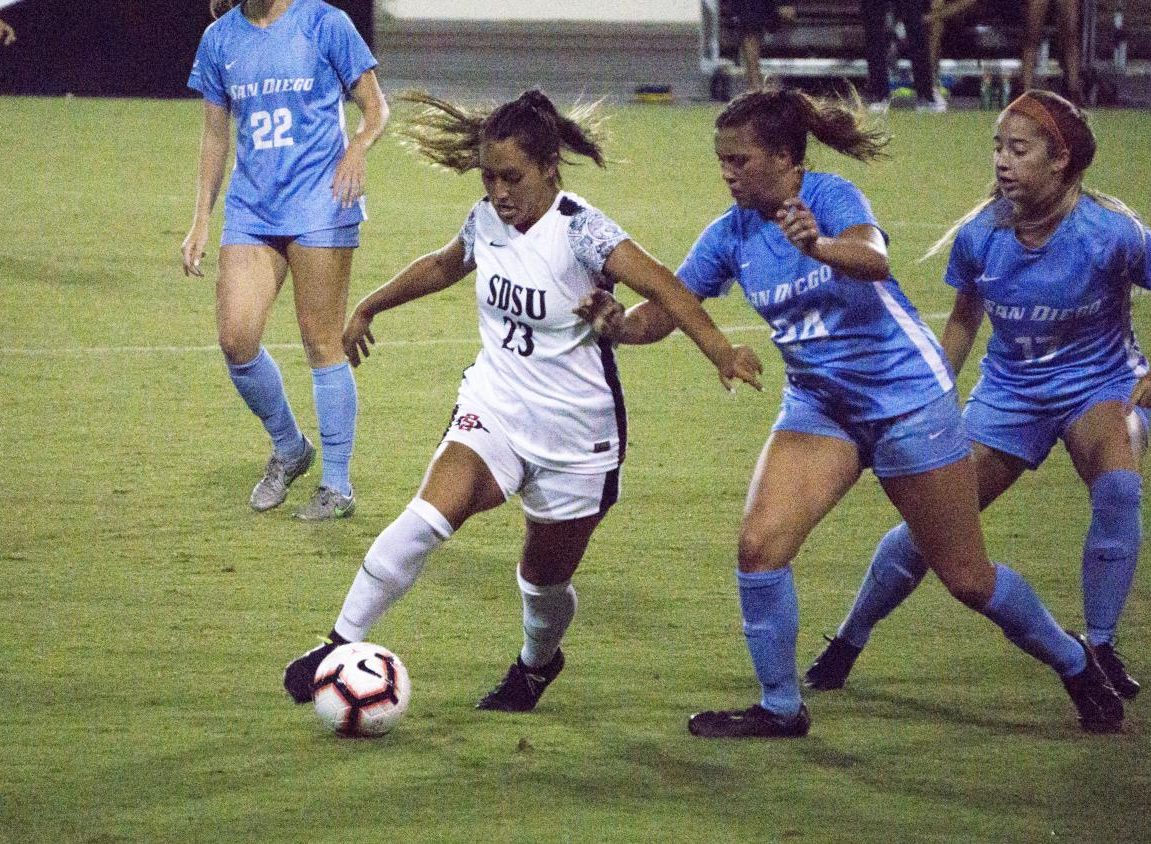 Junior forward Veronica Avalos attempts to keep possession away from the USD defenders during the Aztecs' 1-0 loss on Sept. 13 at the SDSU Sports Deck.