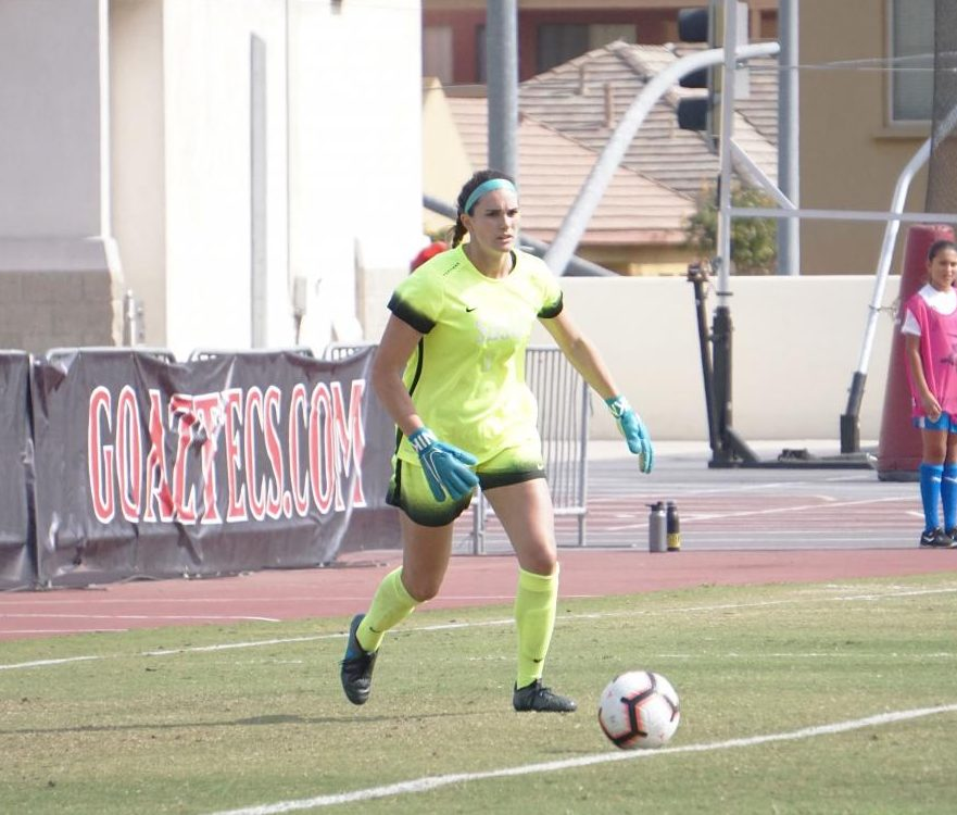 Aztecs senior goalkeeper Brooke Lisowski attempts to kick the ball to get the offense started during the Aztecs' 3-0 victory over San José State on Oct. 27 at the SDSU Sports Deck.
