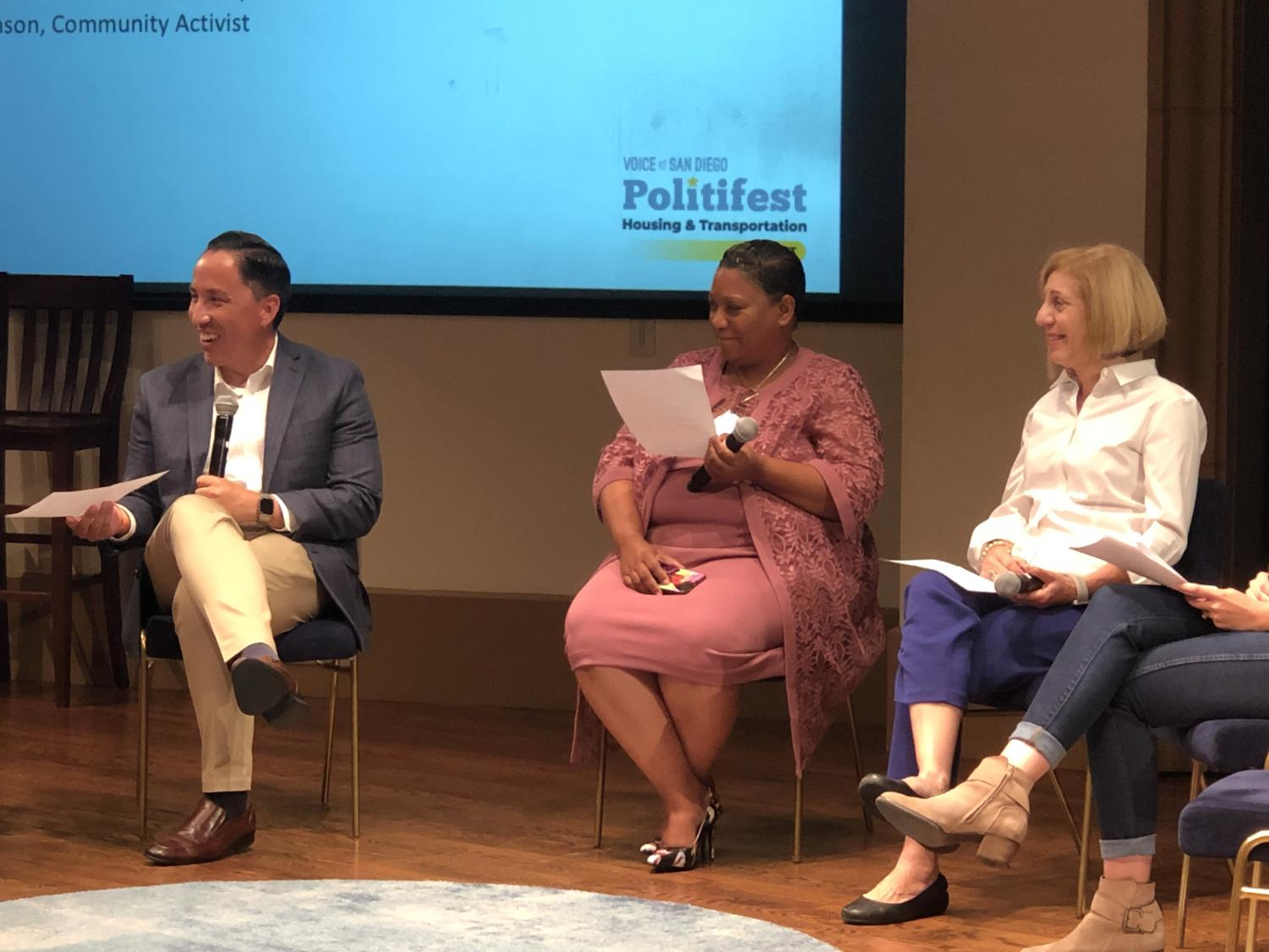 (Left to right) Todd Gloria, Tasha Williamson and Barbara Bry sit alongside one another during a mayoral debate hosted by Voice of San Diego on Oct. 26 at the University of San Diego.