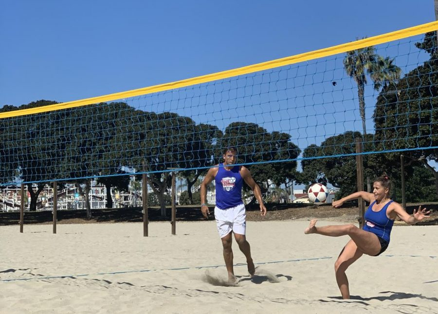 Jovan Obradovic (left) and Beesan Abder-Ruhman (right) attempt to send the ball over the net without the use of their hands during a footvolley tournament on Oct. 12 at Mission Beach.