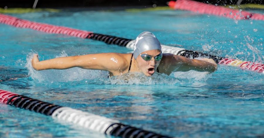 A San Diego State swimmer competes in the breaststroke in the Aztecs' first home meet of the season against Pepperdine and Boise State on Oct. 18, 2019 at the Aztec Aquaplex.