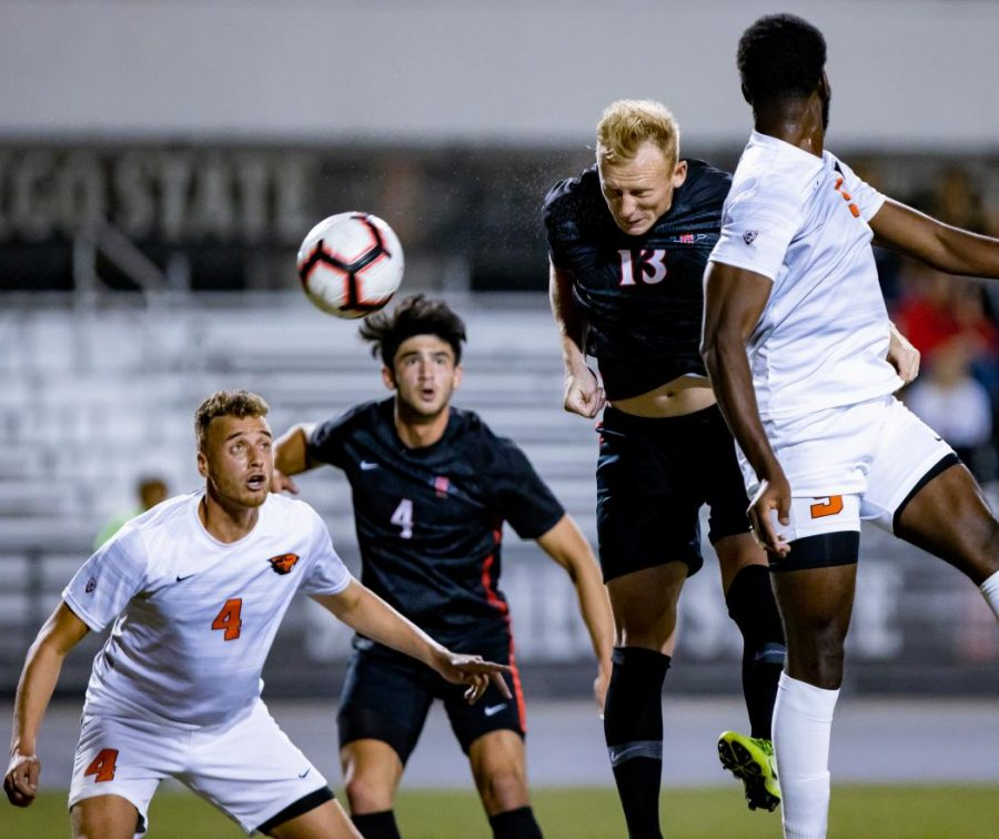 Senior defender Miles Stray heads the ball during the Aztecs' 1-0 loss to Oregon State on Oct. 24 at the SDSU Sports Deck.