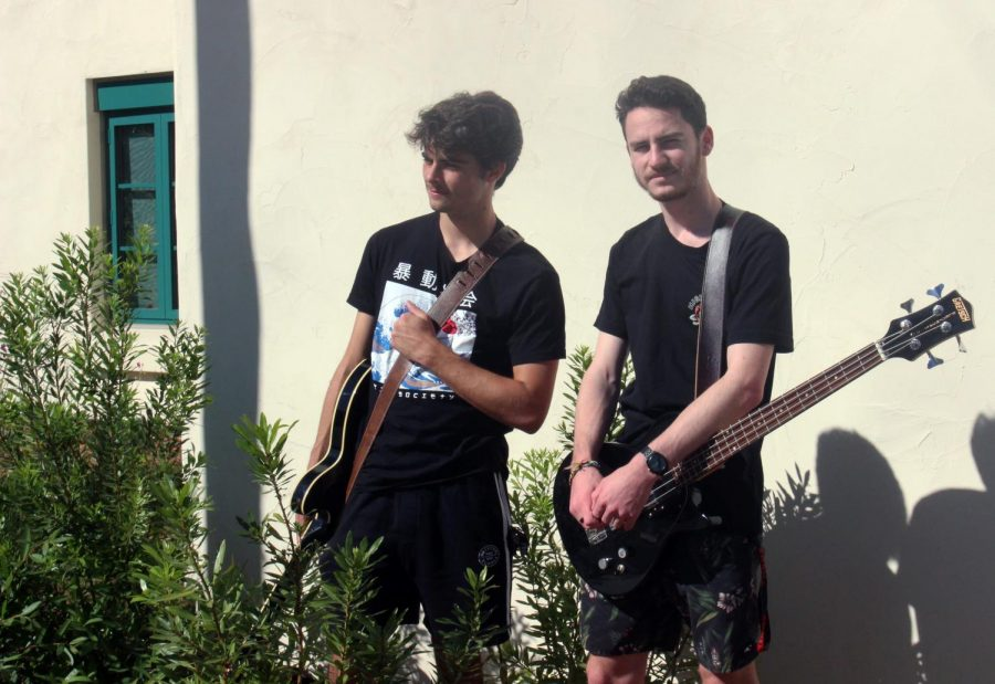 Max Conahey, left, plays rhythm guitar with his friend Nate Williams, right, who is the vocalist and bass player.
