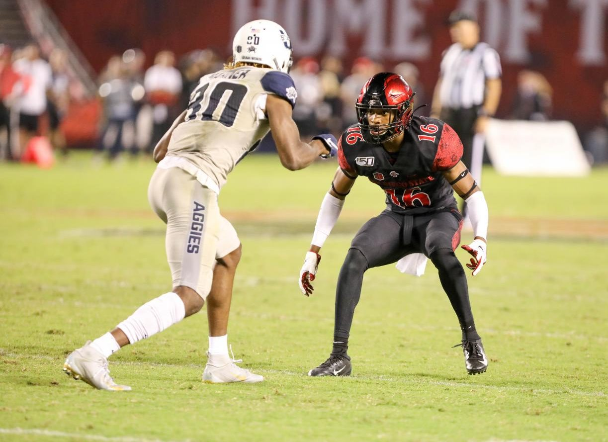 Senior cornerback Luq Barcoo drops back in coverage against Utah State senior wide receiver Siaosi Mariner during the Aztecs' 23-17 loss to the Aggies on Sept. 21 at SDCCU Stadium.