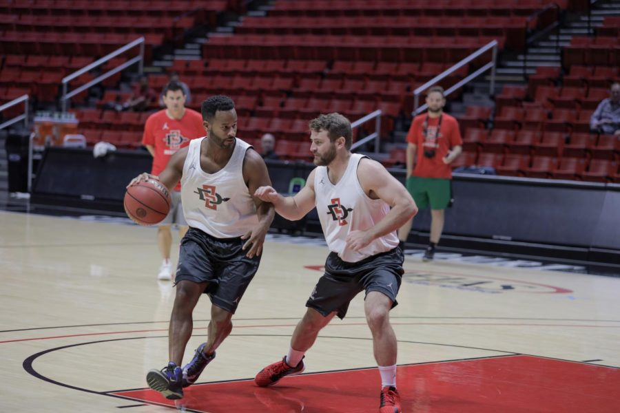 Two campers competing against each other during a five-on-five match at the second annual Aztec Fantasy Camp on Sept. 28 at Viejas Arena.