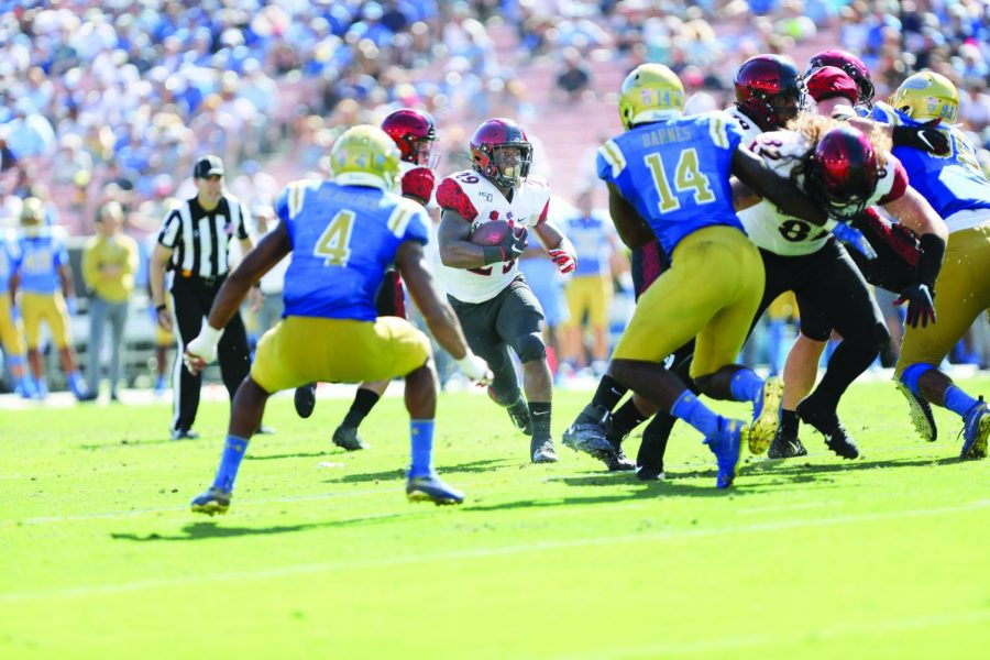 Senior+running+back+Juwan+Washington+looks+to+run+the+ball+upfield+in+the+Aztecs%27+23-14+win+over+UCLA+on+Sept.+7+at+the+Rose+Bowl+in+Pasadena%2C+Calif.