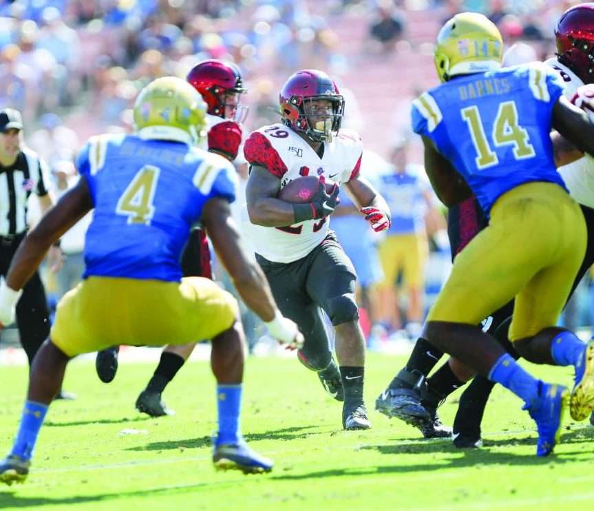Senior running back Juwan Washington looks to run the ball upfield in the Aztecs' 23-14 win over UCLA on Sept. 7 at the Rose Bowl in Pasadena, Calif.