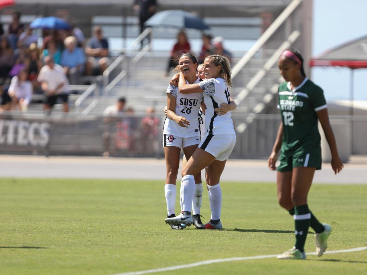 Freshman forward Rachelle Elve (28) celebrates with her teammates after scoring a goal during the Aztecs' 2-0 win over Colorado State on Sept. 29 at the SDSU Sports Deck.