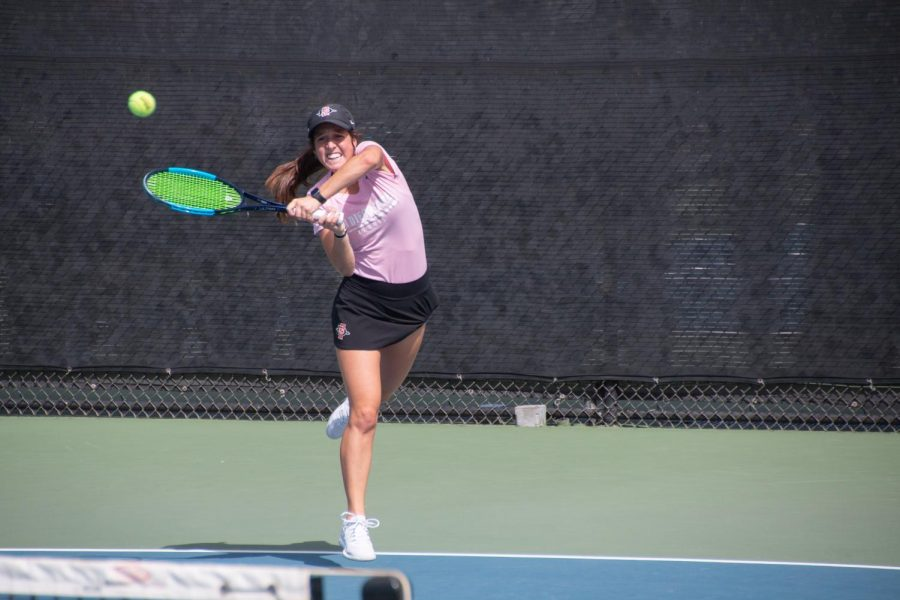 Junior Abbie Mulbarger swings at the ball during the SDSU Fall Classic I on Sept. 29, 2019 at Aztec Tennis Center.