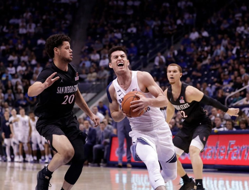 San Diego State junior guard Jordan Schakel (left) attempts to stop the BYU player from scoring during the Aztecs' 76-71 win over BYU on Nov. 9 at the Marriot Center in Provo, Utah.
