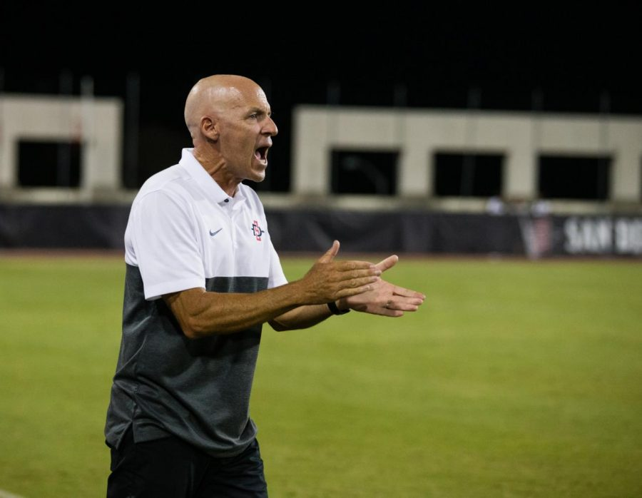 Aztecs women's soccer head coach Mike Friesen instructs his players during a game at the SDSU Sports Deck.