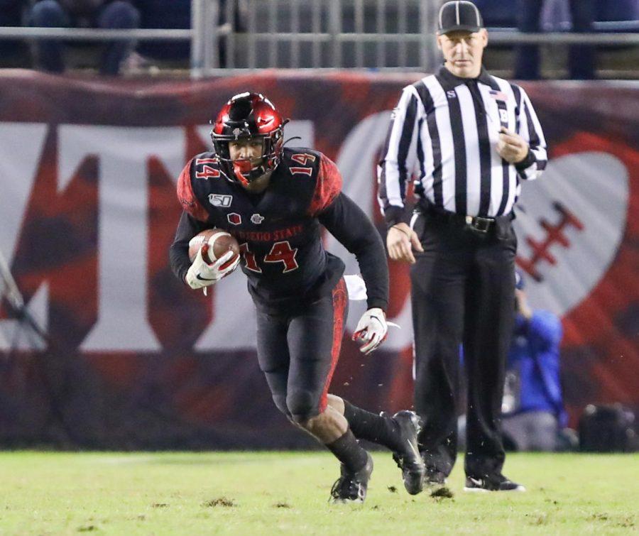 Aztecs junior safety Tariq Thompson picks off BYU sophomore quarterback Zach Wilson during SDSUs 13-3 victory on Nov. 30 at SDCCU Stadium.