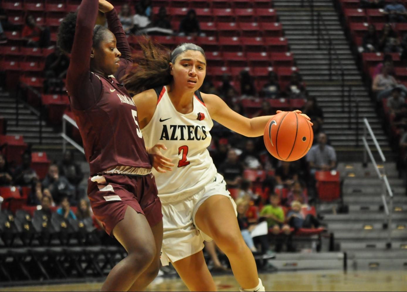 Sophomore guard Sophia Ramos attempts to shrug off the Alabama A&M defender during the Aztecs' 61-53 loss on Nov. 14 at Viejas Arena.