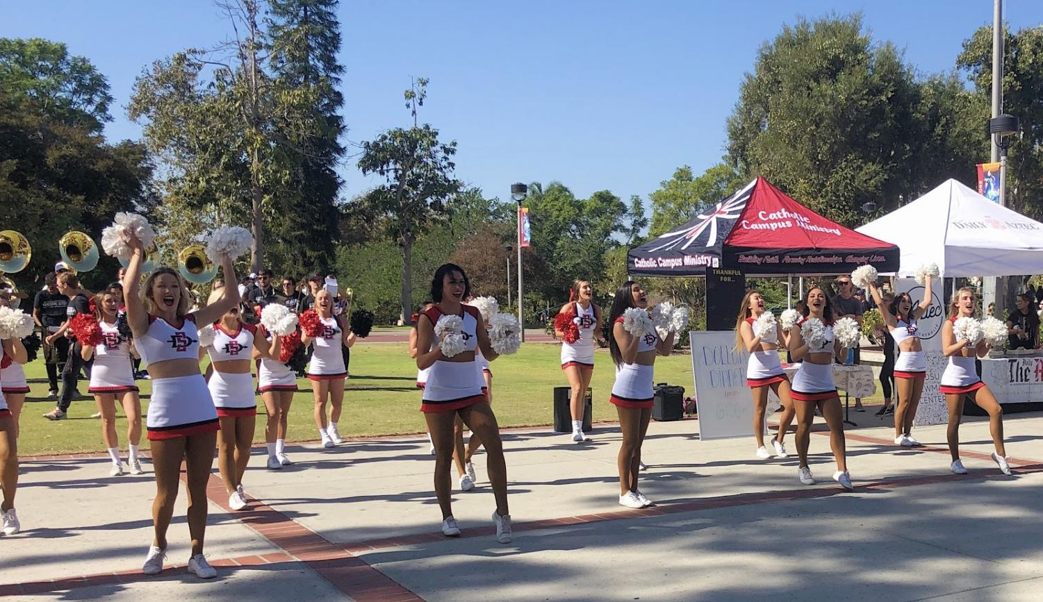 SDSU's cheer team and the school band perform on Campanile walkway.