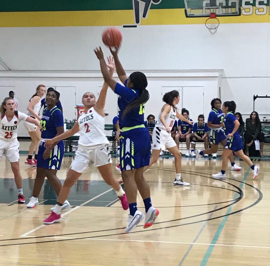 SDSU+sophomore+guard+Sophia+Ramos+contests+a+shot+during+the+Aztecs%27+77-56+victory+over+Westcliff+University+on+Nov.+12+at+Grossmont+College.+The+game+was+moved+from+Viejas+Arena+to+Grossmont+College+due+to+the+campus-wide+power+outage+that+occurred+that+day.