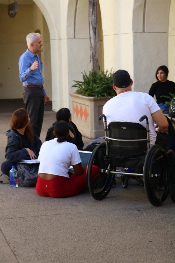 Biology professor Chris Glembotski meets with his students outside Student Services East due to a campus power outage on Nov. 12.