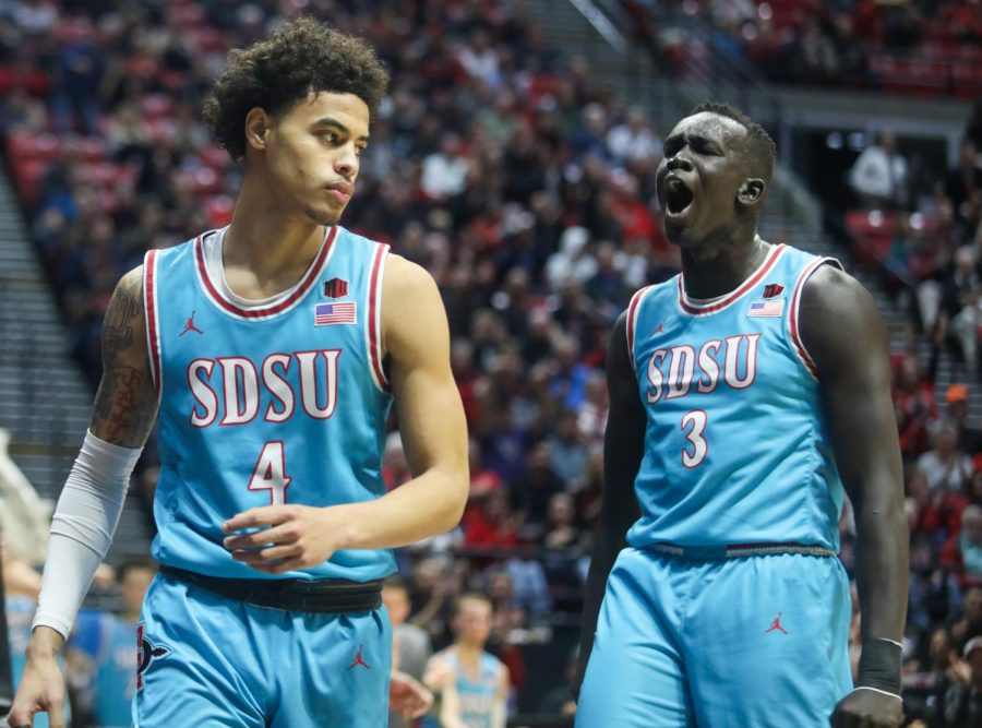 Sophomore forward Aguek Arop (right) is pumped up after a play during the Aztecs' 62-49 win over Tennessee State  on Nov. 25 at Viejas Arena.