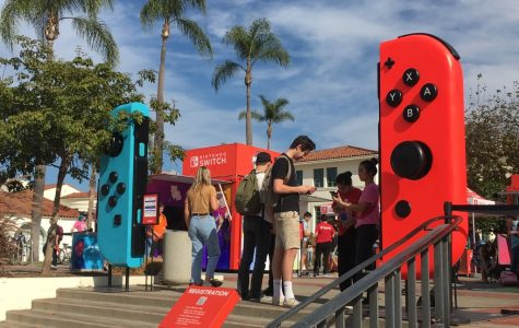 Students lined up to play Nintendo games during the promotion of the Nintendo Switch Lite.