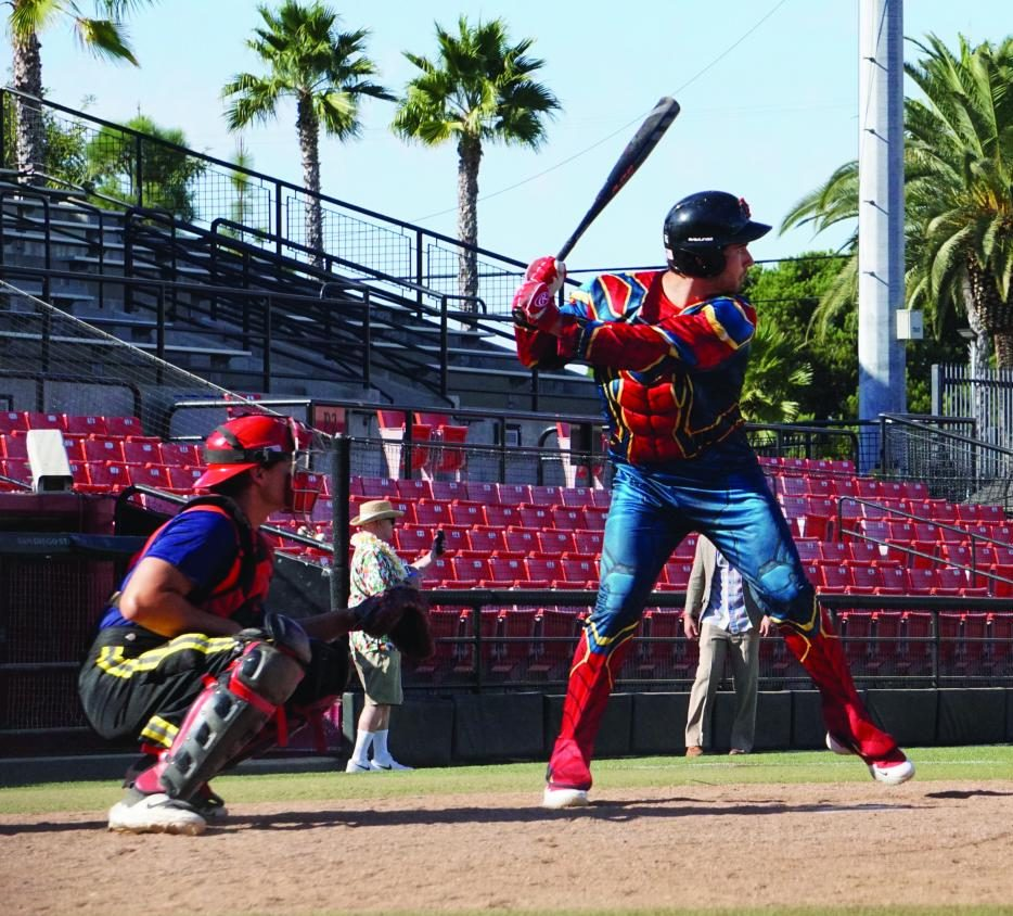 Freshman pitcher Johnny Guzman prepares to face a pitch during the Aztecs' annual Halloween game on Nov. 2 at Tony Gwynn Stadium while dressed as Spider-Man.