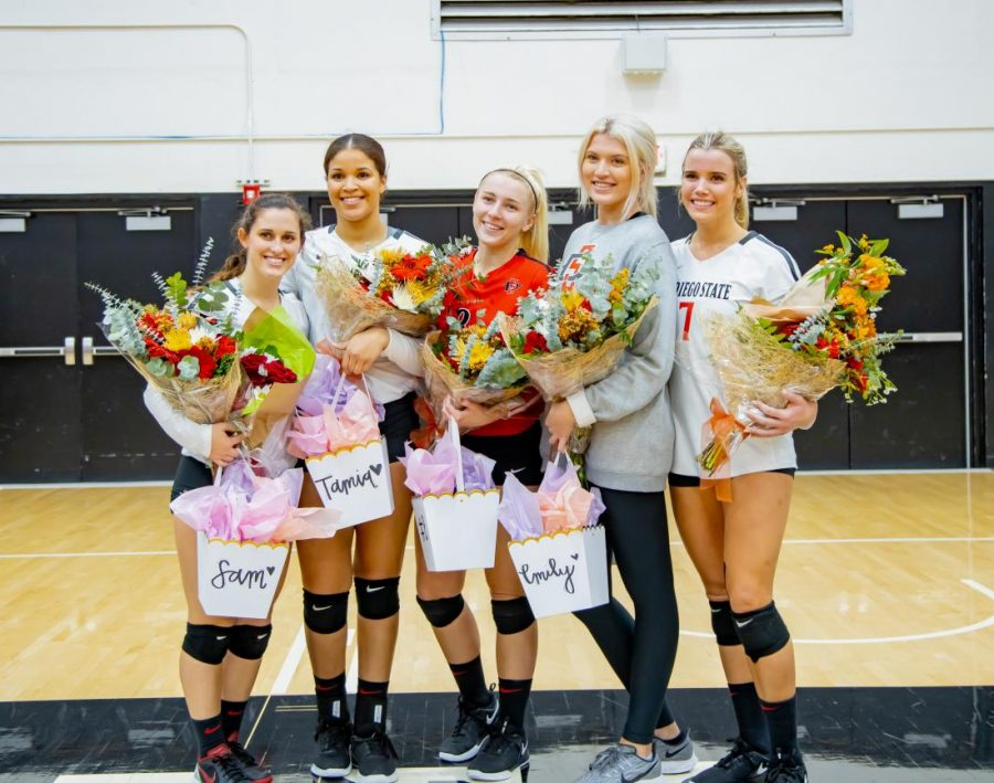 (Left to right) Defensive specialist Sam McGrath, middle blocker Tamia Reeves, defensive specialist Loren Teter, Emily Burns and outside hitter Hannah Turnlund pose for a photo on Senior Night before the Aztecs' 3-1 victory over Air Force on Nov. 14 at Peterson Gym.