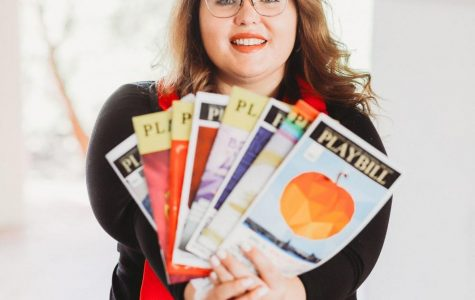 Faulkner holds the playbills of all of the plays she has covered for The Daily Aztec.