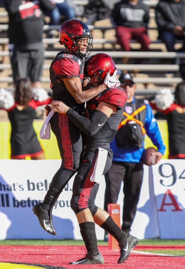 Sophomore running back Jordan Byrd embraces senior quarterback Ryan Agnew after a touchdown run.