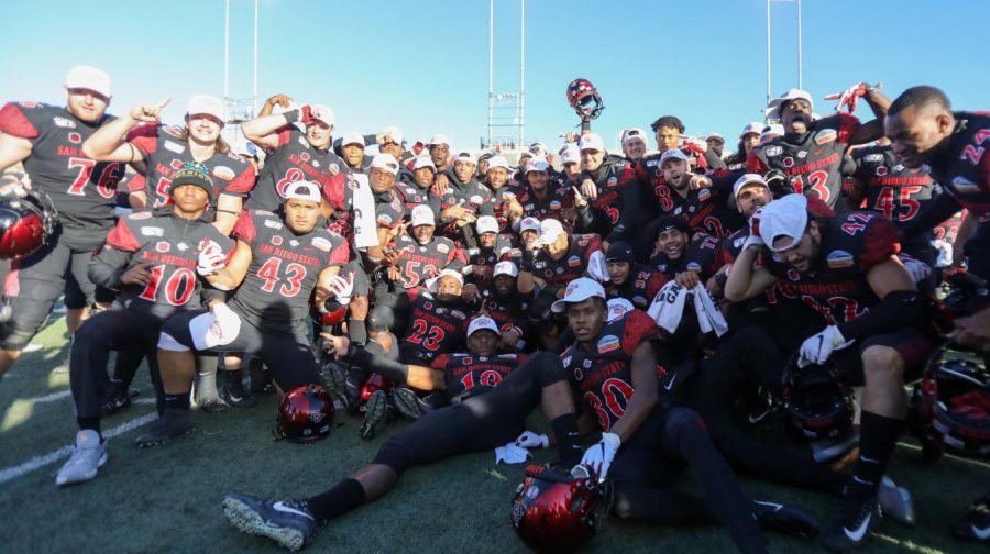 The Aztecs celebrate with their bowl championship hats after their 48-11 victory over Central Michigan on Dec. 21 at Dreamstyle Stadium in Albuquerque, New Mexico.
