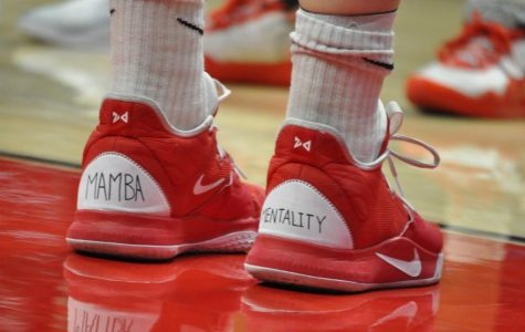 "Senior center Zayn Dornstauder honors Kobe Bryant by writing on her sneakers ""Mamba Mentality."""