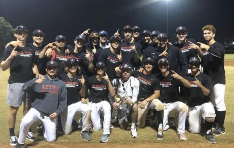 The club baseball team poses for a group shot after a game.