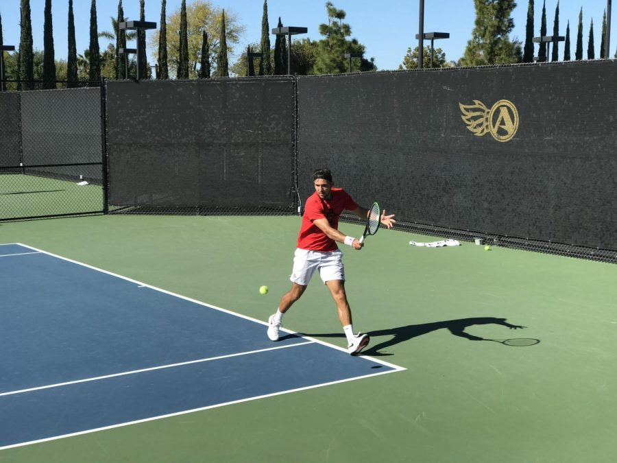 Aztecs%27+senior+Fabian+Roensdorf+attempts+to+hit+the+ball+past+his+opponent+against+Oklahoma+State+on+Jan.+12+at+the+Aztec+Tennis+Center.