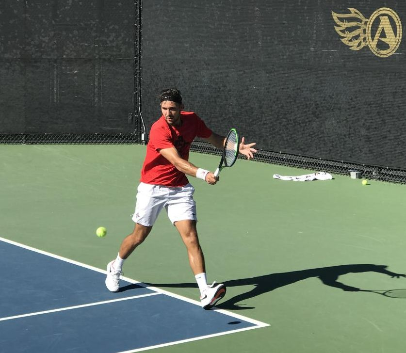 Aztecs' senior Fabian Roensdorf attempts to hit the ball past his opponent against Oklahoma State on Jan. 12 at the Aztec Tennis Center.