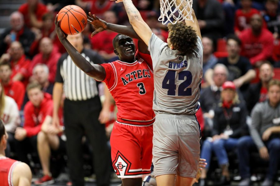 Sophomore forward Aguek Arop tries to go up to the rim.