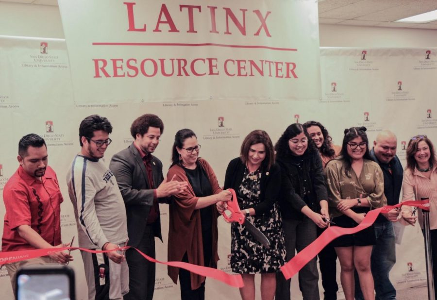 Administrators and community members unveil the new Latinx Resource Center inside Love Library.