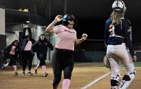 Junior outfielder Alexa Schultz celebrates as she scored the walk-off run to give SDSU the 3-2 victory in the eighth inning against Cal State Fullerton on Feb. 14 at SDSU Softball Stadium.