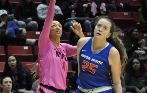 Senior forward Monique Terry fires a 3-pointer over a Boise State defender during the Aztecs' 69-67 overtime loss on Feb. 15 at Viejas Arena.