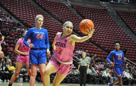 Sophomore guard Sophia Ramos attempts to control the ball during the Aztecs' 69-67 loss to Boise State on Feb. 15 at Viejas Arena. Ramos finished the game with a career-high in rebounds (14).