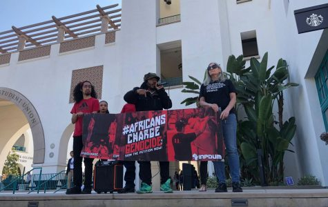 Students and faculty representing the Africans Charge Genocide group protest the potential ban on two guest speakers accused of anti-Semitism.