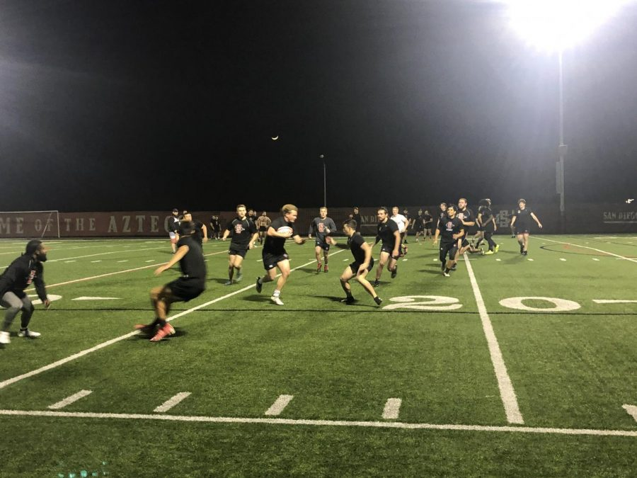 The+rugby+club+team+practices+Tuesdays+and+Thursdays+at+night.