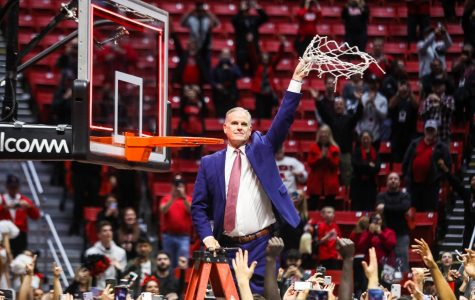 SDSU men's basketball head coach Brian Dutcher cuts the nets after defeating New Mexico for the Mountain West regular-season title on Feb. 11 at Viejas Arena.