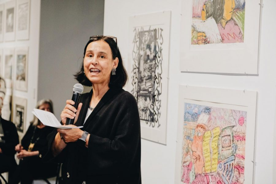 Norma Iglesias-Prieto also spoke in front of the art to the audience. She curated the exhibit.