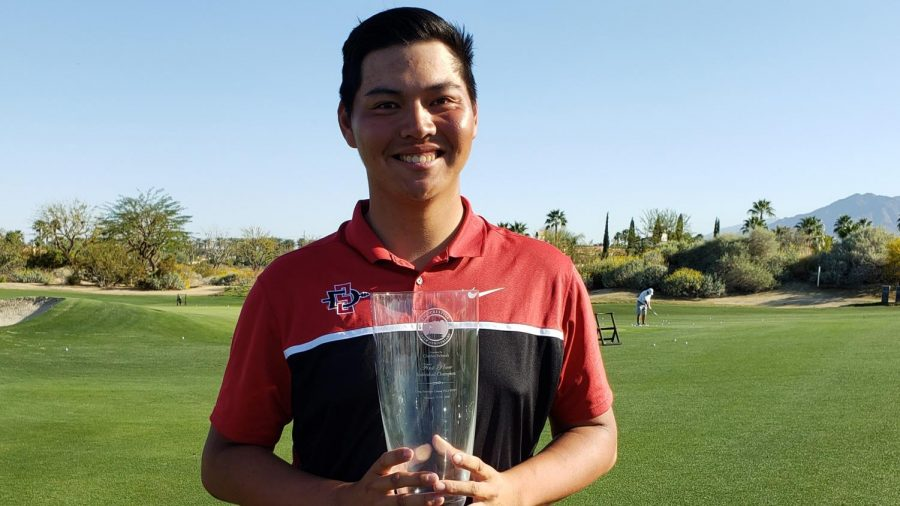 SDSU sophomore golfer Leo Oyo holds the first-place trophy of The Prestige tournament.