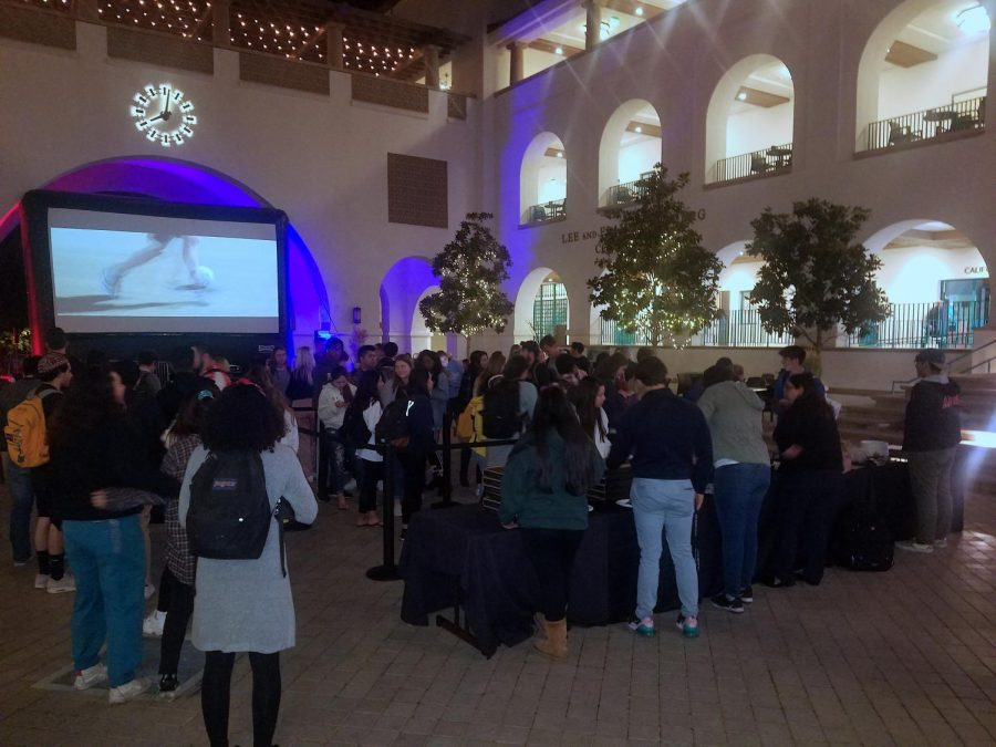 Students gather in the Aztec Student Union courtyard to watch election night coverage on March 3.