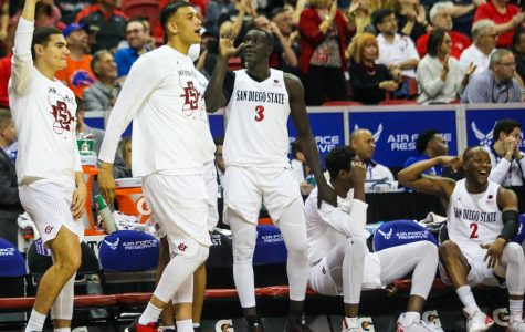 The Aztec bench celebrates during its 73-60 win over Air Force in the Mountain West tournament quartfinal at the Thomas and Mack Center on March 5.