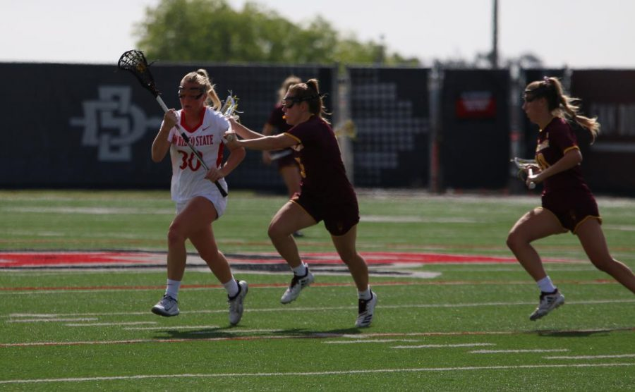 Junior midfielder Bailey Brown attempts to run the ball upfield during the Aztecs' 19-18 win over Arizona State on Feb. 20 at Aztec Lacrosse Field.